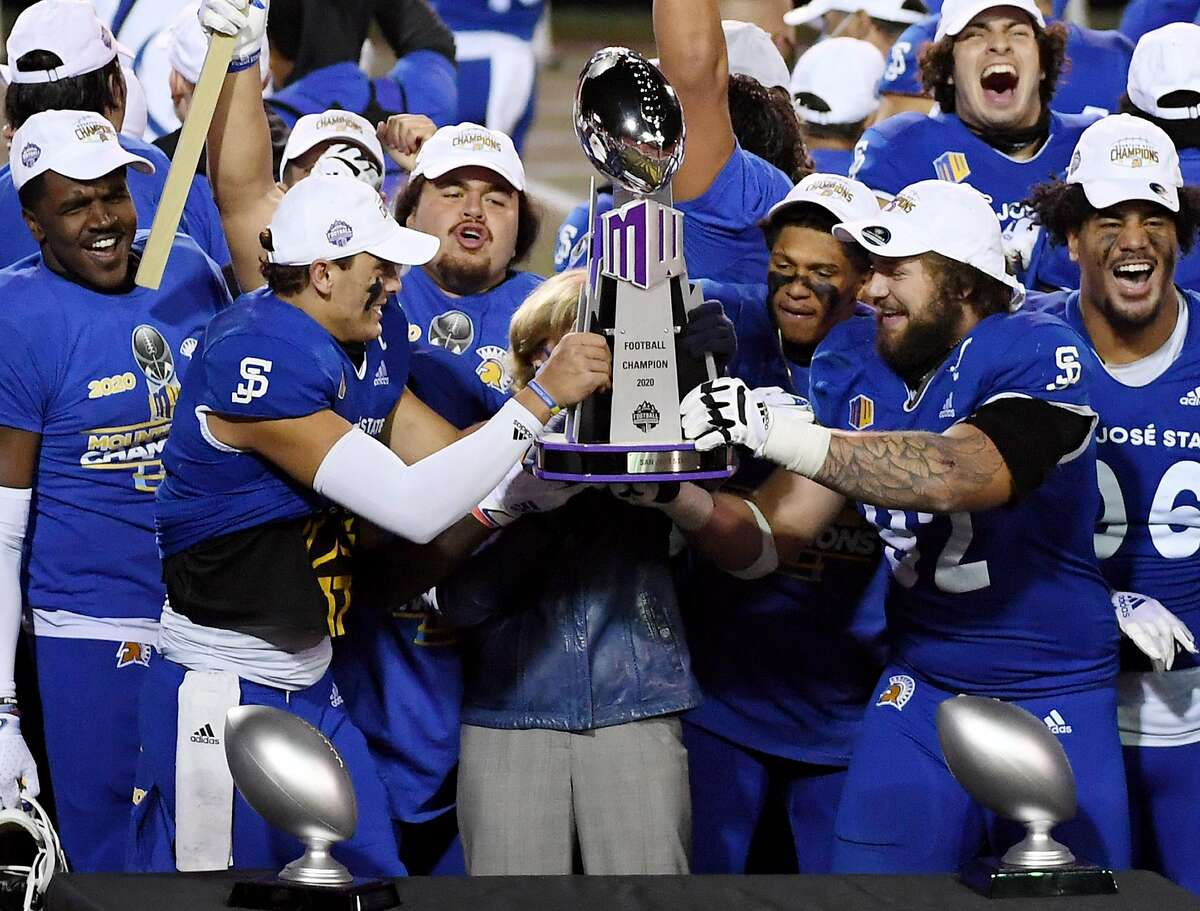 LAS VEGAS, NEVADA - DECEMBER 19: Quarterback Nick Starkel (2nd L) #17 and defensive lineman Cade Hall #92 lift the championship trophy after defeating the Boise State Broncos 34-20 to win the Mountain West Football Championship at Sam Boyd Stadium on December 19, 2020 in Las Vegas, Nevada. (Photo by Ethan Miller/Getty Images)