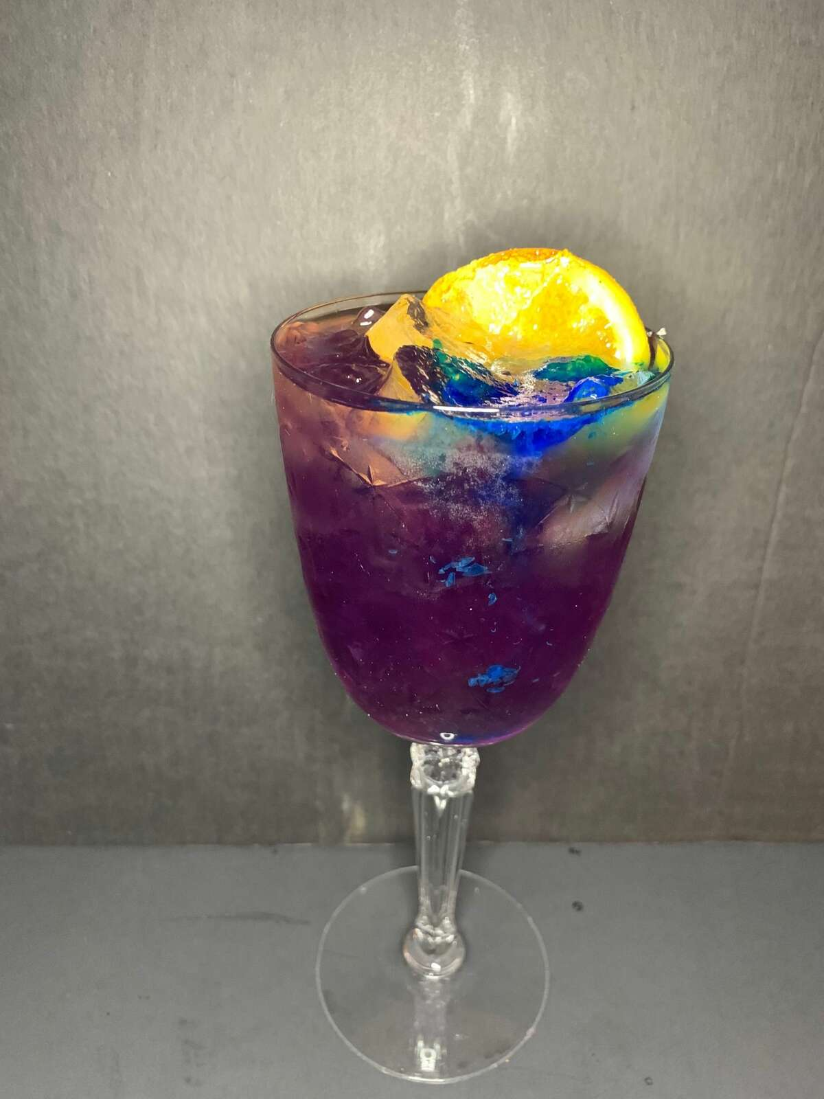A color-changing Abracadabra cocktail, made with butterfly pea extract.