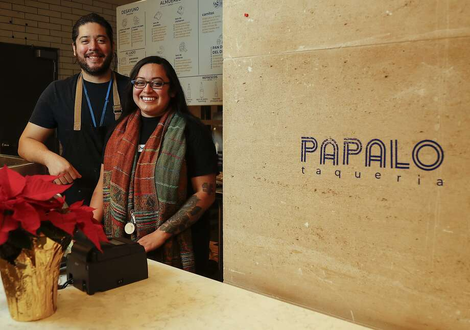 Chefs Nicolas Vera and Stephanie Velasquez, of Tlahuac and Papalo at their Papalo kitchen in Finn Hall, downtown, Tuesday, December 15, 2020, in Houston. Velasquez, a pastry chef, supplies pastries to Giant Leap Coffee, while Vera cooks Central American cuisine featuring locally sourced ingredients, heirloom corn tortillas (blue, yellow, red corn), fresh pan dulce and desserts. Their Greenway Plaza food court pop up closed at the end of its term, and their Papalo Taqueria at Finn Hall only survived 3 weeks until the pandemic shut it down. But the couple has been doing popular supper and brunch pop-ups on weekends at How to Survive on Land and Sea. And they are aiming to open their E End brick and mortar in 2021. Photo: Karen Warren, Staff Photographer