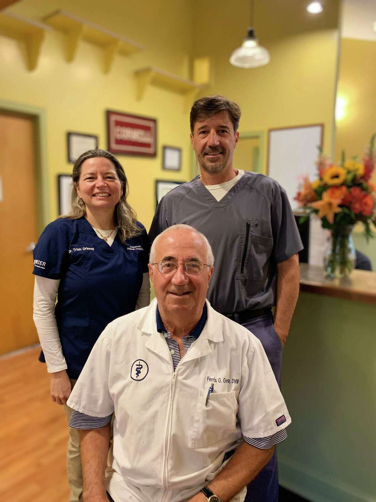 Aspetuck Animal Hospital in New Preston turned 50 in September. Founded by veterinarian Ferris Gorra, front, the business is now co-owned by Ferris' son, Michael Gorra, and Patricia Grinnell, in back row.
