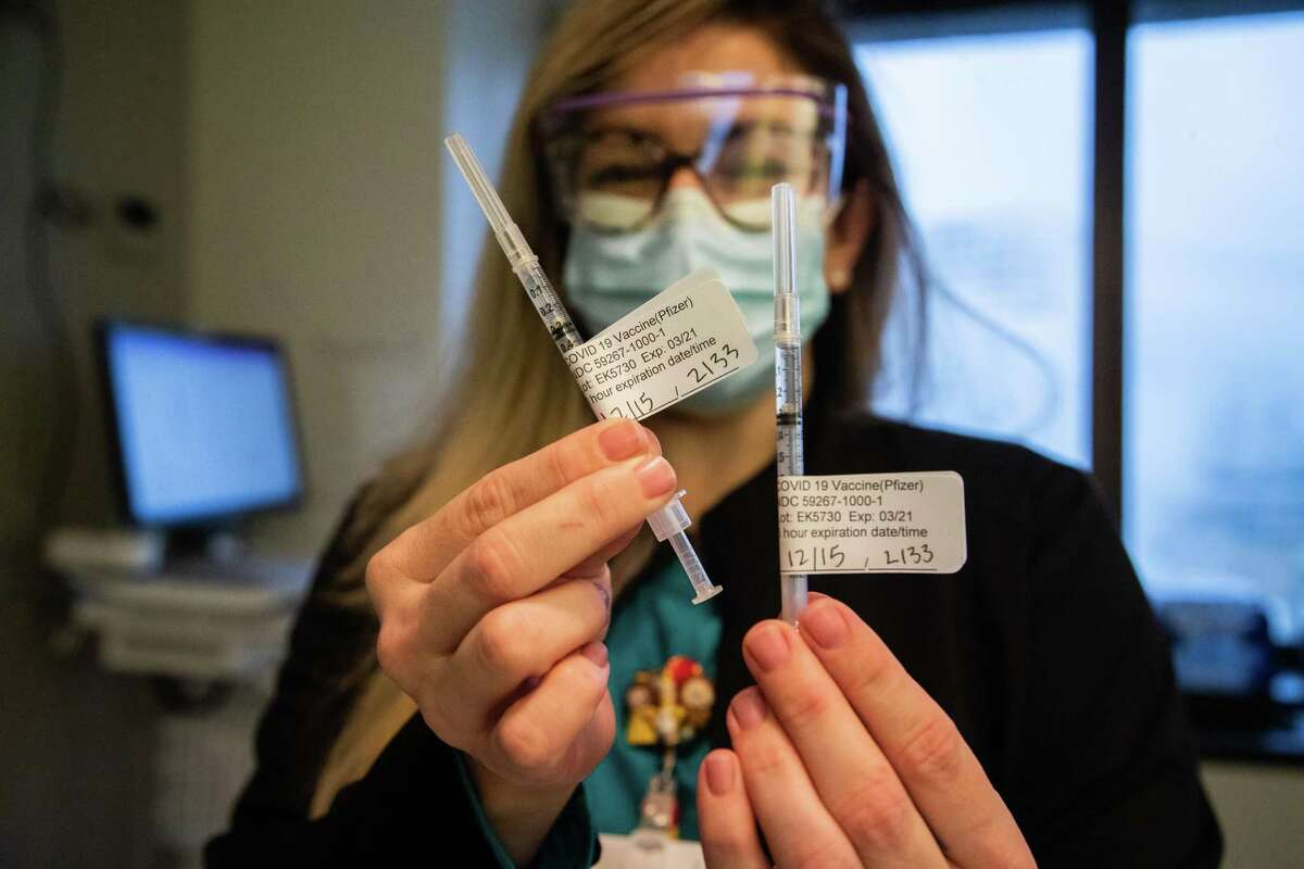 Baylor St. Luke's Medical Center registered nurse Linda Fletcher holds Pfizer COVID-19 vaccines on the first day Baylor St. Luke's Medical Center start immunizing their staff, Tuesday, Dec. 15, 2020, in Houston.