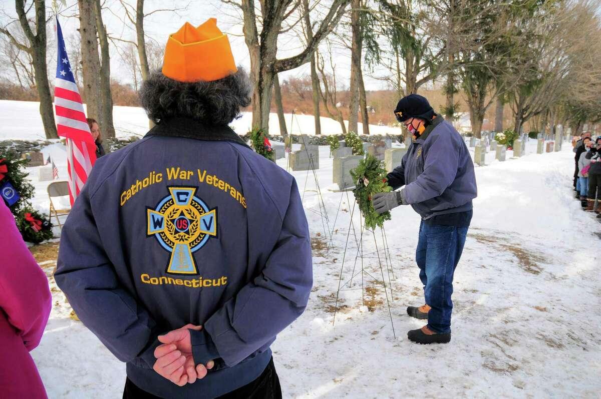 Catholic War Veterans Post 1562 Commander Tom Voytek places a wreath in honor of U.S. Navy veterans.