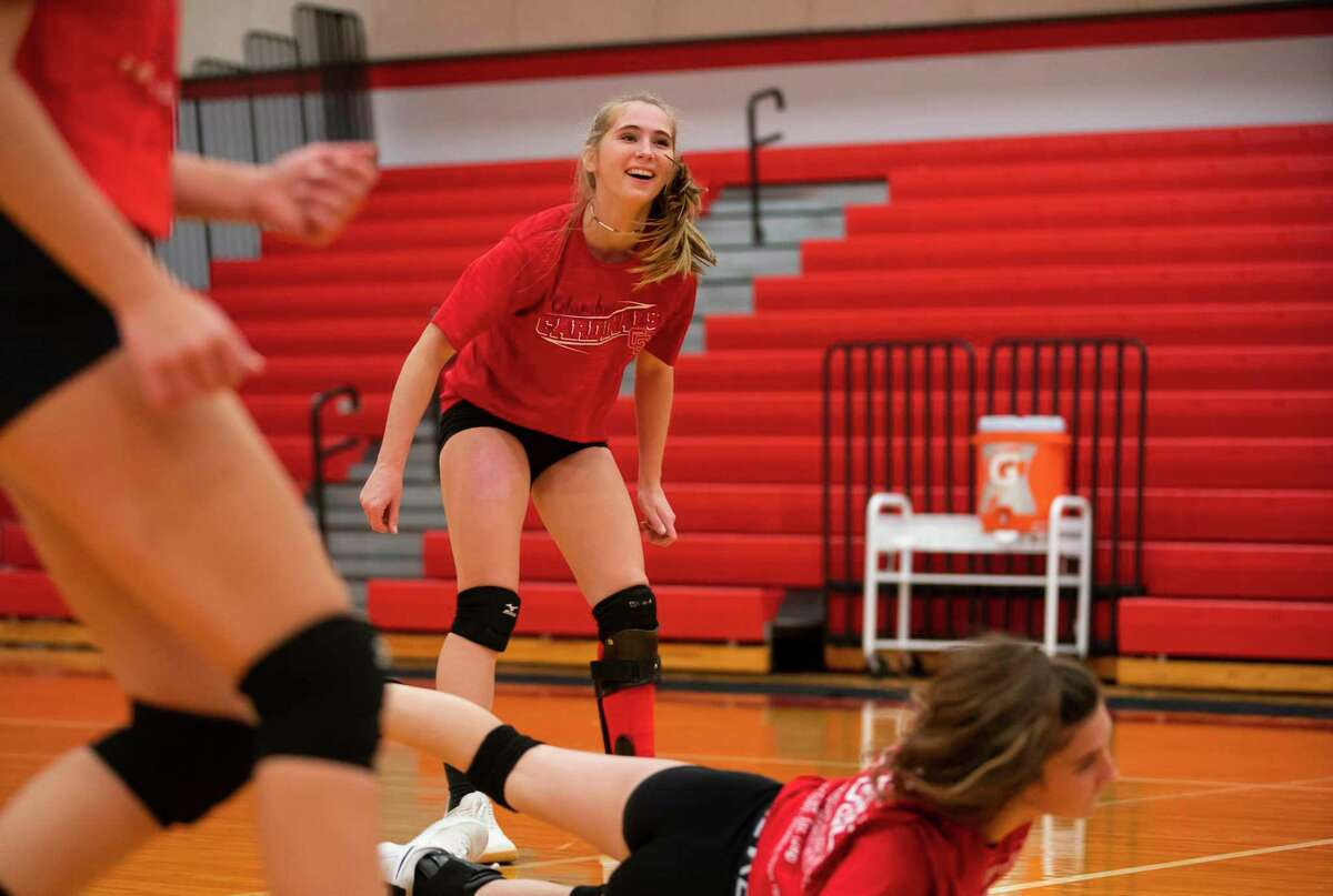 Madalene Edmiston, 15, practices with her volleyball team, Tuesday, Nov. 17, 2020, at Columbus High School in Columbus, TX. After losing the front part of her left foot after an accident on an ATV earlier this year, Madalene has used physical therapy and a new prosthetic to get her back playing on the volleyball court with her teammates.