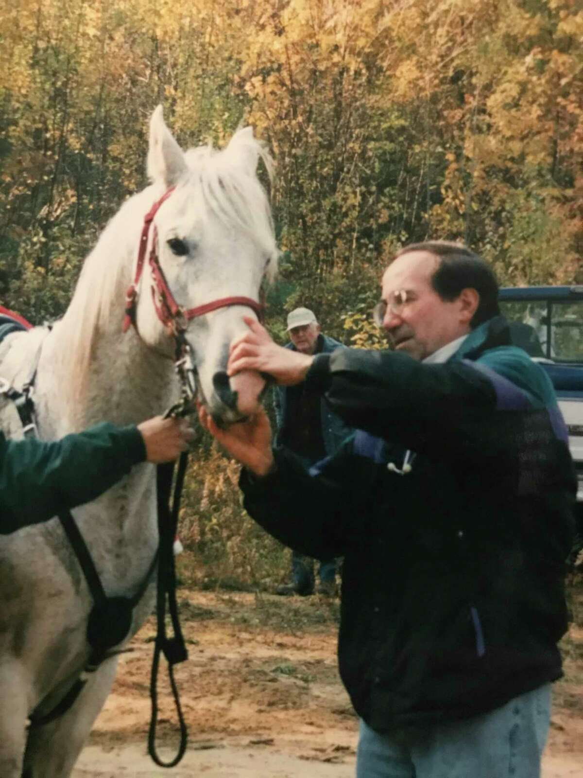 Aspetuck Animal Hospital in New Preston turned 50 in September. Founded by veterinarian Ferris Gorra, the business is now co-owned by Ferris' son, Michael Gorra, and Patricia Grinnell. Above is a photograph of Ferris examining a horse in the early years of his practice.