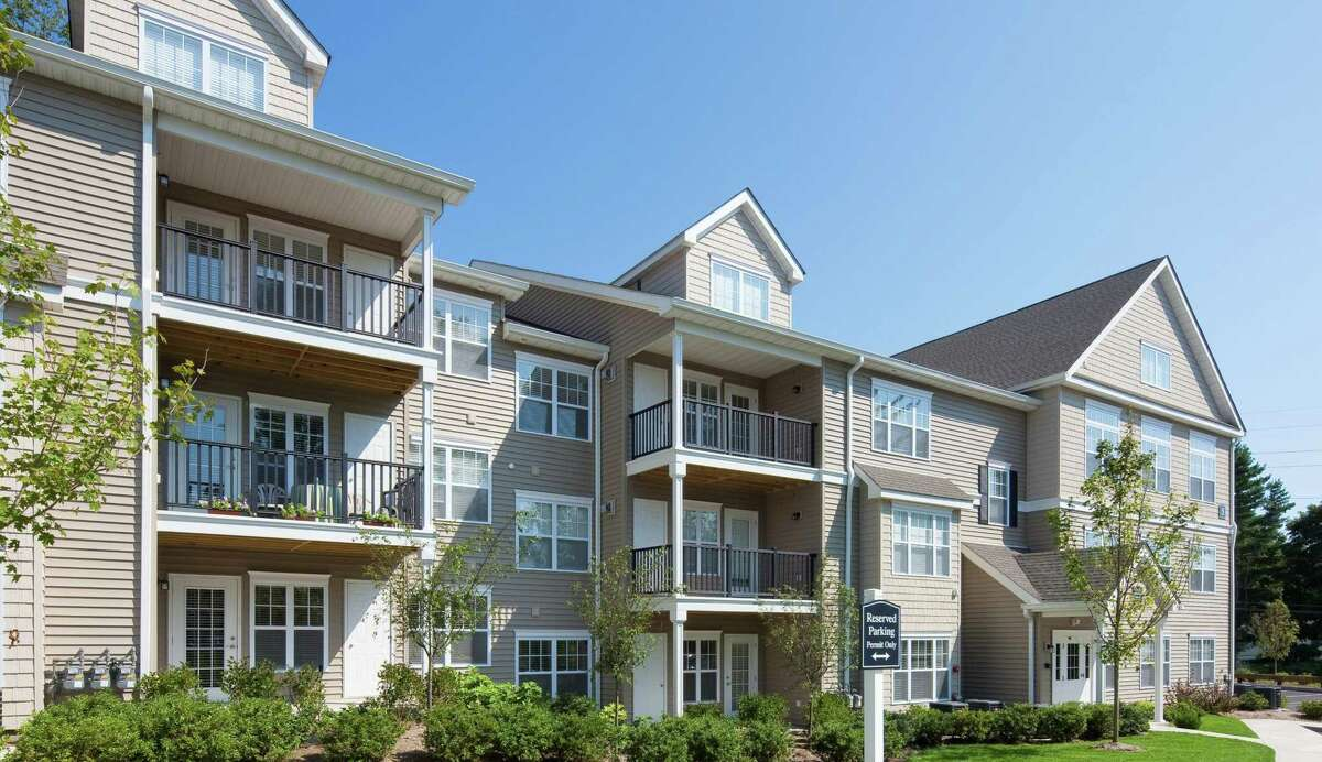The former Avalon Wilton at Danbury Road apartments in Wilton, Conn., which have been renamed White Oaks at Wilton after Clarion Partners purchased the 100-unit property in December 2020 for nearly $35 million. (Press photo courtesy CBRE)