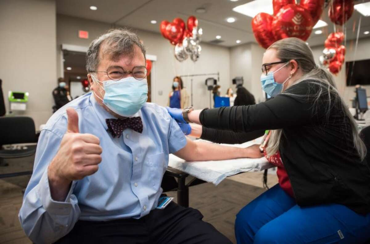 Infectious disease and vaccine expert Dr. Peter Hotez gets his first shot of the Pfizer vaccine.