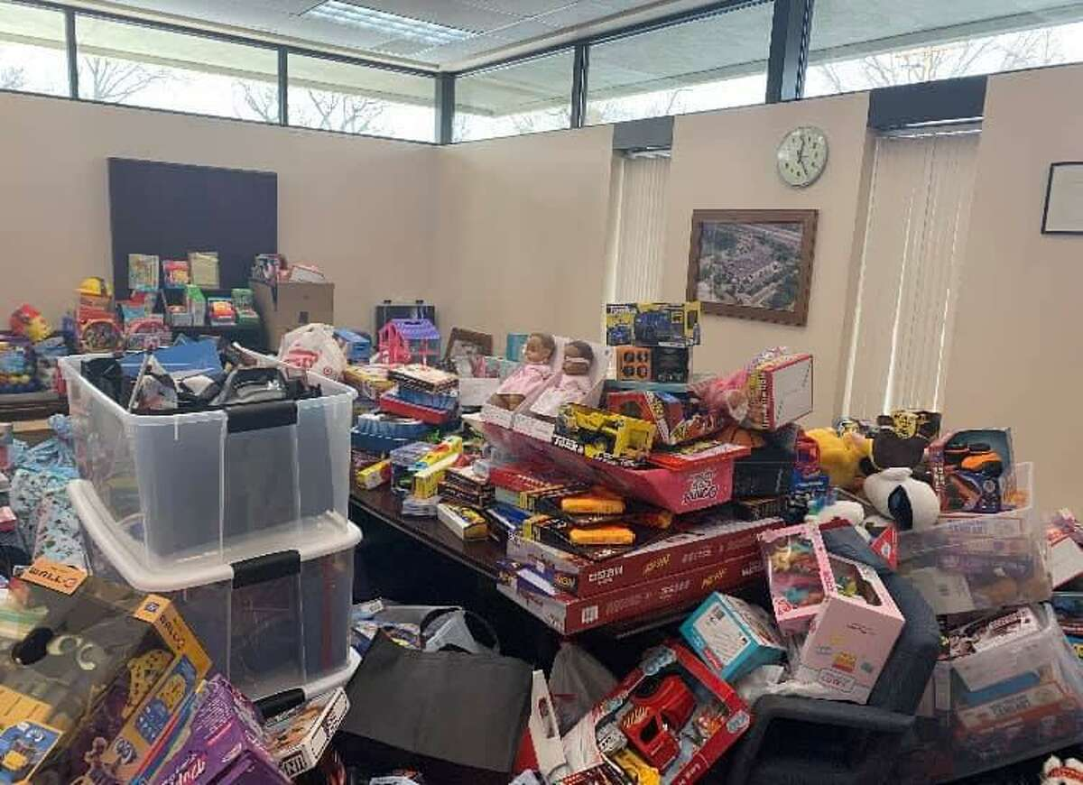 The toy deliveries arrive at the Troop G barracks in Bridgeport, Conn., on Saturday, Dec. 19, 2020. State police said all the toys donated will go to children throughout Fairfield and New Haven counties.