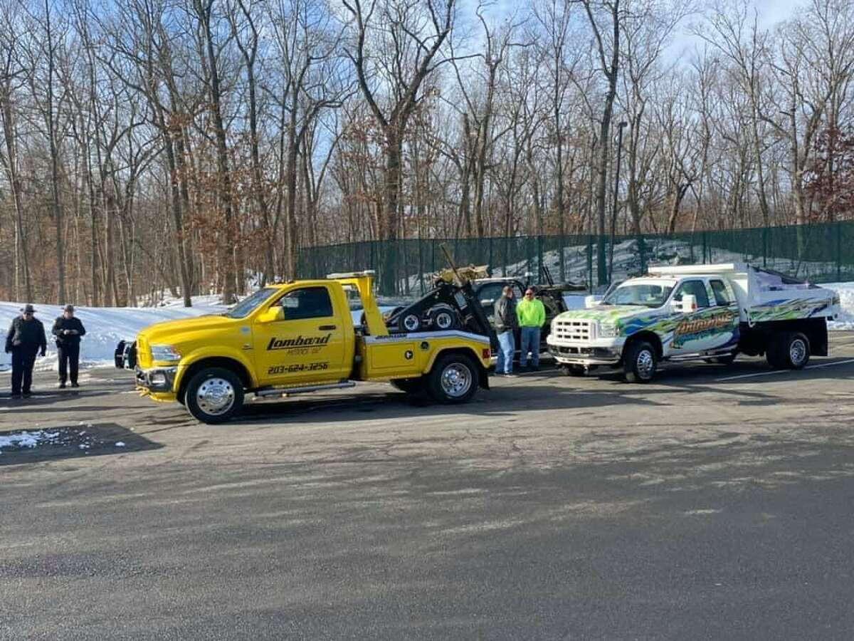 Some of the tow truck companies involved in the delivery for the annual Troop G holiday toy drive on Saturday, Dec. 19, 2020.