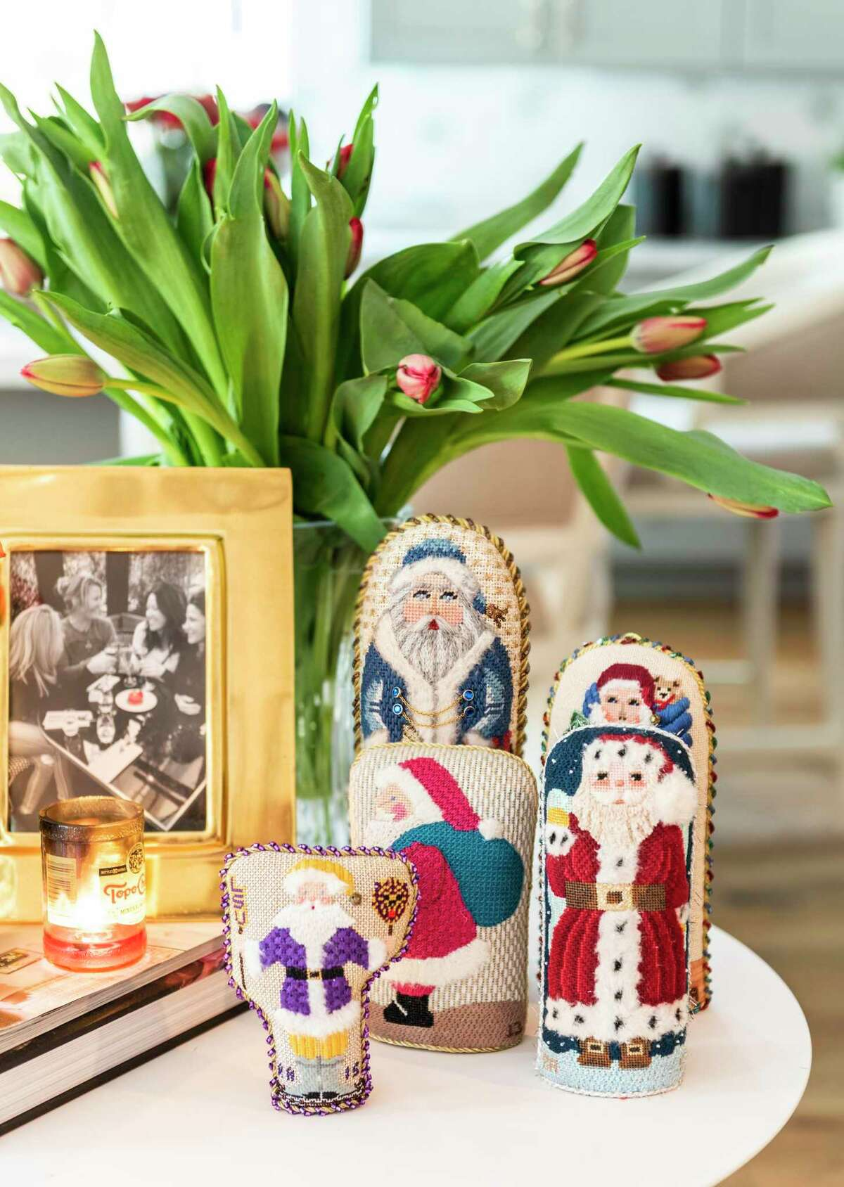 These cute needlepoint figures sit on a side table.