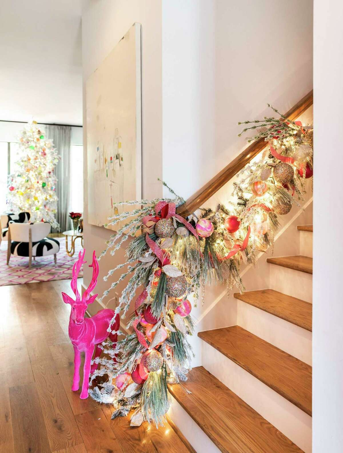 Gust's home has plenty of pink, so this bright pink reindeer is right at home at the base of stairs.