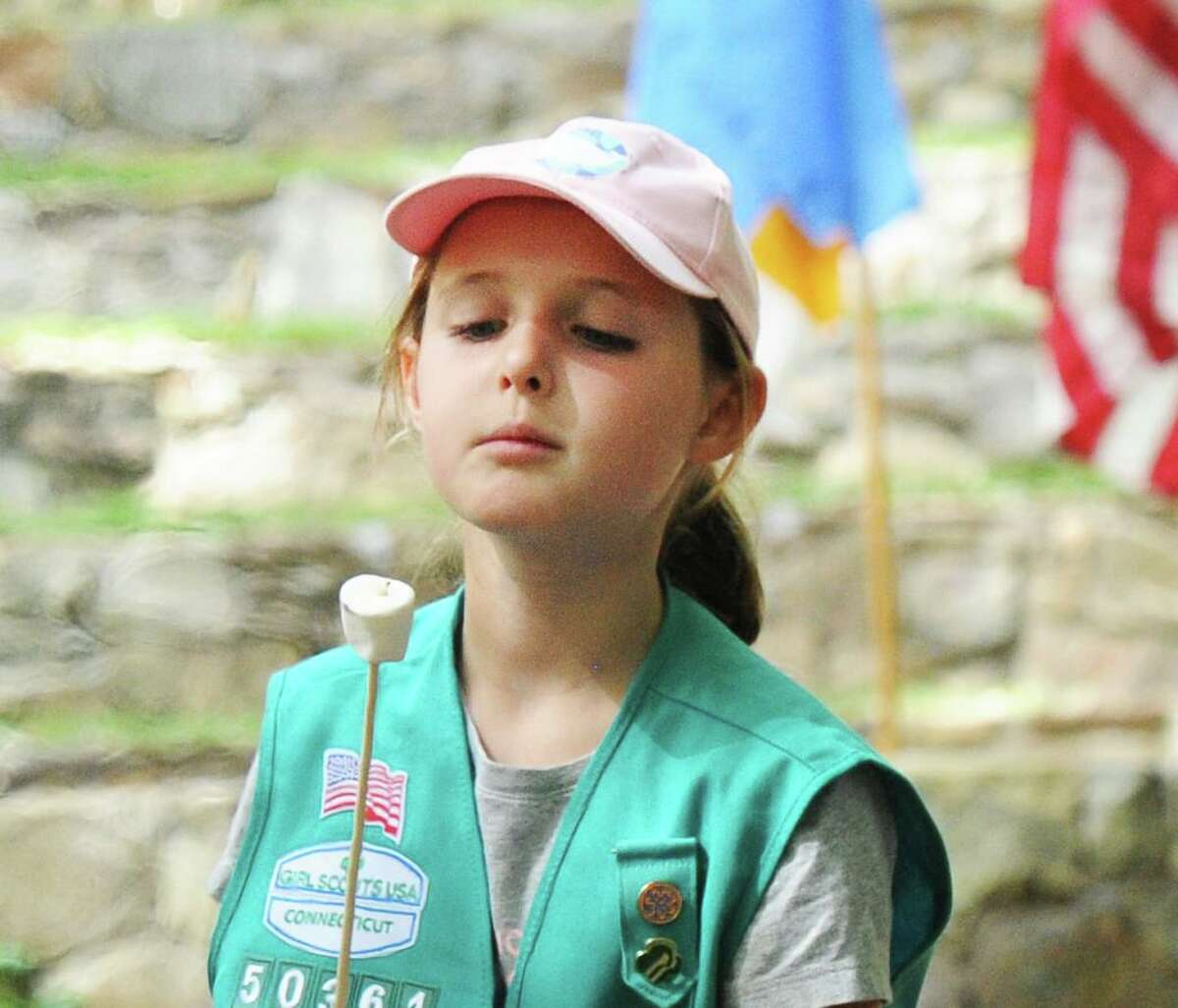 Greenwich Girl Scout Alexa Tobias, 9, checked her marshmallow during a campfire roast that was part of the Greenwich Girl Scouts