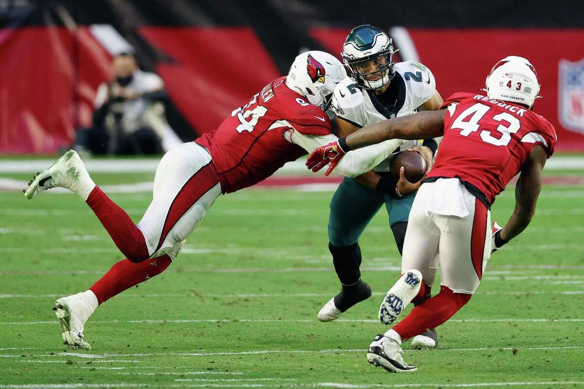 GLENDALE, ARIZONA - DECEMBER 20: Jalen Hurts #2 of the Philadelphia Eagles is sacked by Zach Allen #94 and Andy Lee #4 of the Arizona Cardinals during the third quarter at State Farm Stadium on December 20, 2020 in Glendale, Arizona. (Photo by Christian Petersen/Getty Images)