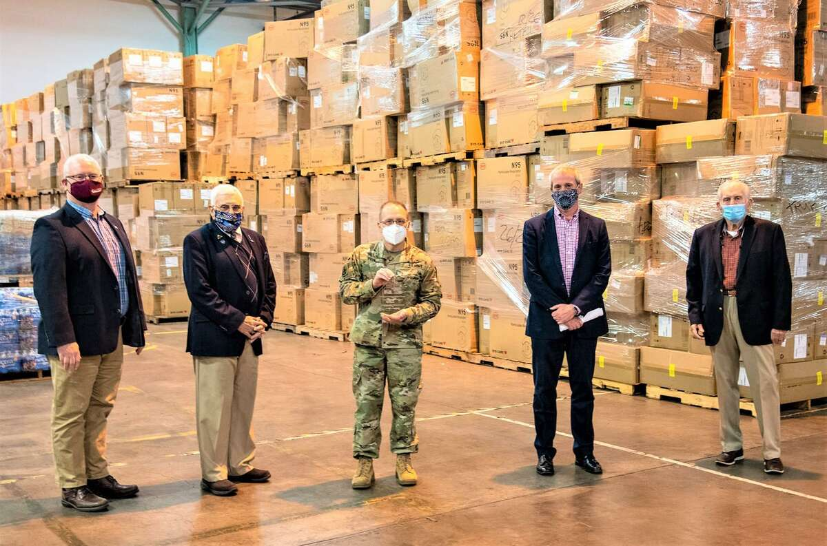 A contingent from the Middlesex County Chamber of Commerce visited the Connecticut National Guard PPE Distribution Warehouse in New Britain Dec. 7. From left are Chamber Chairman Tom Byrne, Chamber Support the Troops Committee Chairman Phil Cacciola, Maj. Gen. Francis J. Evon, AT&T New England President John Emra and President Larry McHugh.