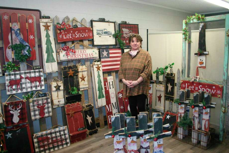 Lynn Cour has set up shop in the newly available Pop-up shop location at 211 N. Main St. in downtown Evart. Cour will be selling her handmade Christmas craft items now through Dec. 23, and plans to return to the shop on a monthly schedule to sell seasonal crafts. (Pioneer photo/Cathie Crew)