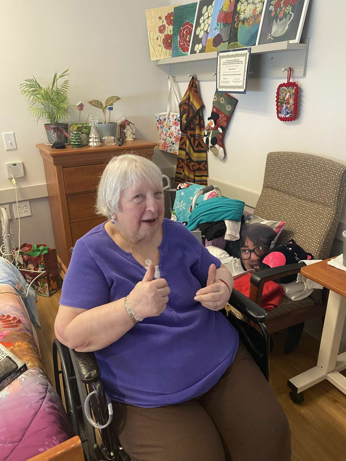 A resident of Shaker Place, the Albany County-run nursing home in Colonie, N.Y., gives a thumbs up after receiving the facility's first vaccination against COVID-19. County officials declined to release the resident's name, citing privacy concerns.