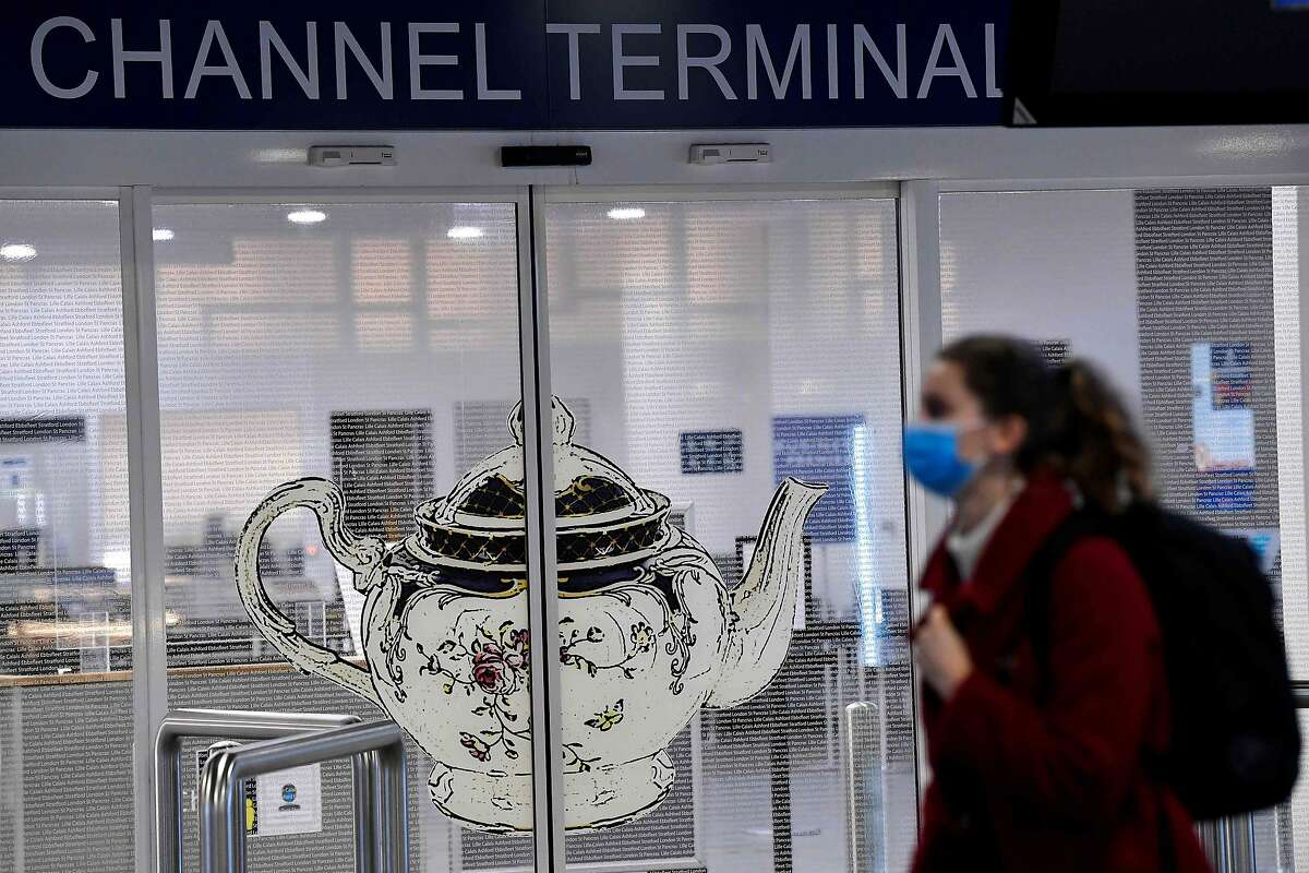A woman walks past the closed entrance of the Eurostar terminal at Brussels South railway station (Gare du Midi), in Brussels.