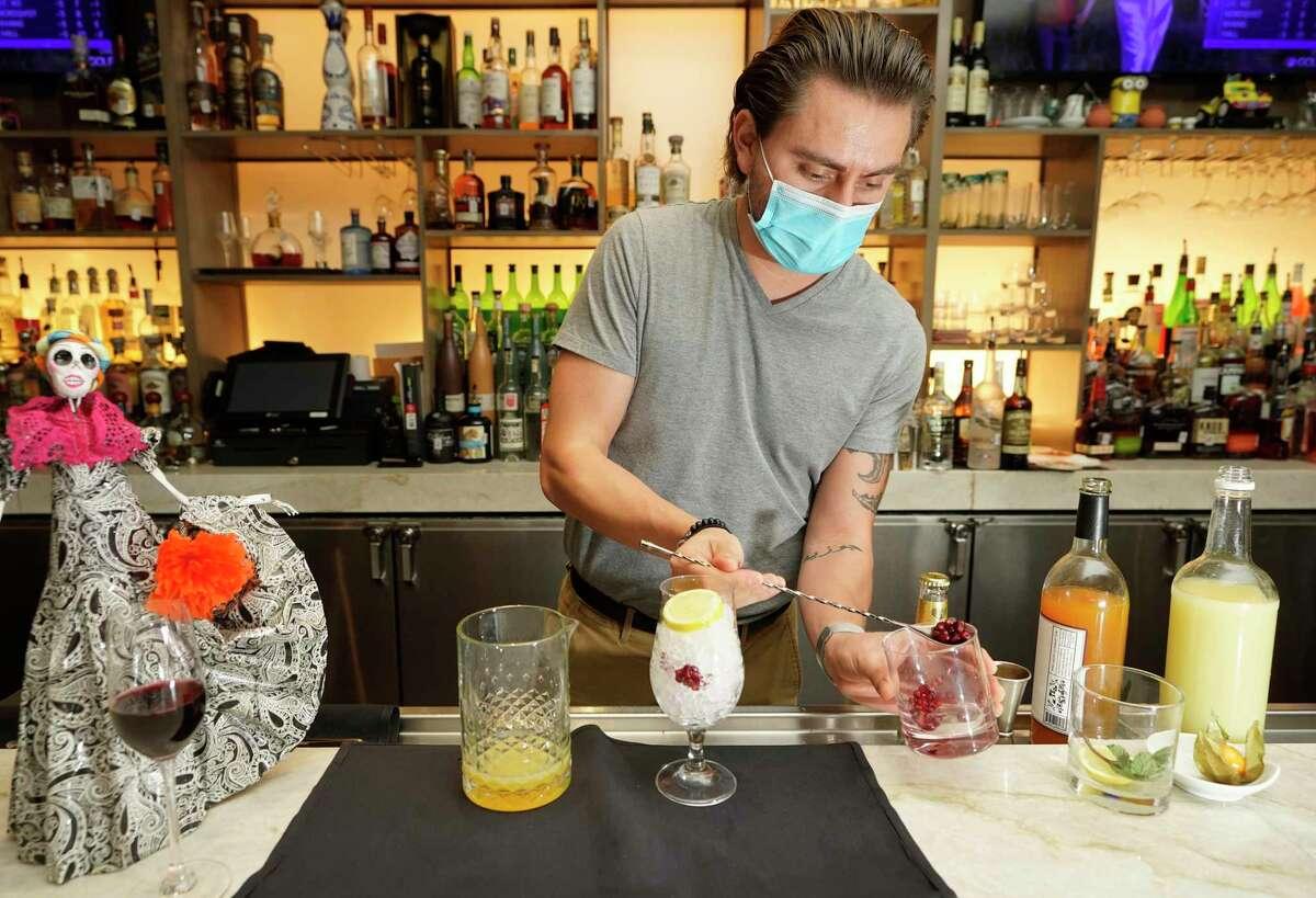 Juan Carlos Camarena, manager, mixes the Mercado de Especias, a zero-proof cocktail (mocktail), shown at Xochi, 1777 Walker Street, Friday, Dec. 18, 2020 in Houston.