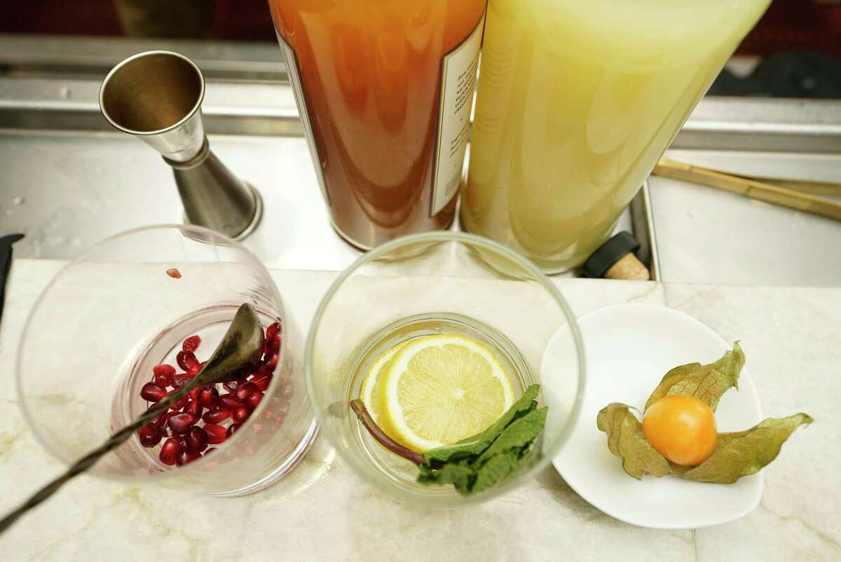 Items including pomegranate seeds, lemons, and a gooseberry, are some of the ingredients used in the Mercado de Especias, a zero-proof cocktail (mocktail), shown at Xochi, 1777 Walker Street, Friday, Dec. 18, 2020 in Houston.