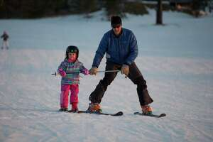 A young skiier and her instructor at Mohawk Mountain Ski Area.