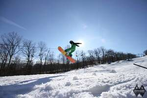 A snowboarder gets air at Powder Ridge Mountain Park in Middlefield.