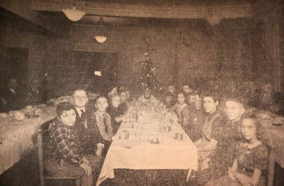 In late December of 1940 the Manistee Rotary Club hosted a big dinner party at the Hotel Chippewa for disabled children living in Manistee County. Photo: Manistee County Historical Museum Photo