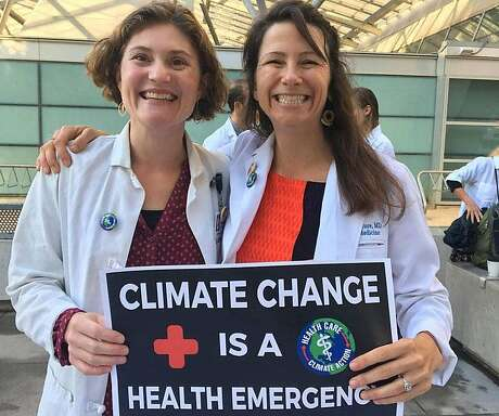 Dr. Amanda Millstein (left) and Dr. Ashley McClure participate in the 2019 Youth Climate Strike march, Sept. 20, 2019 in San Francisco.