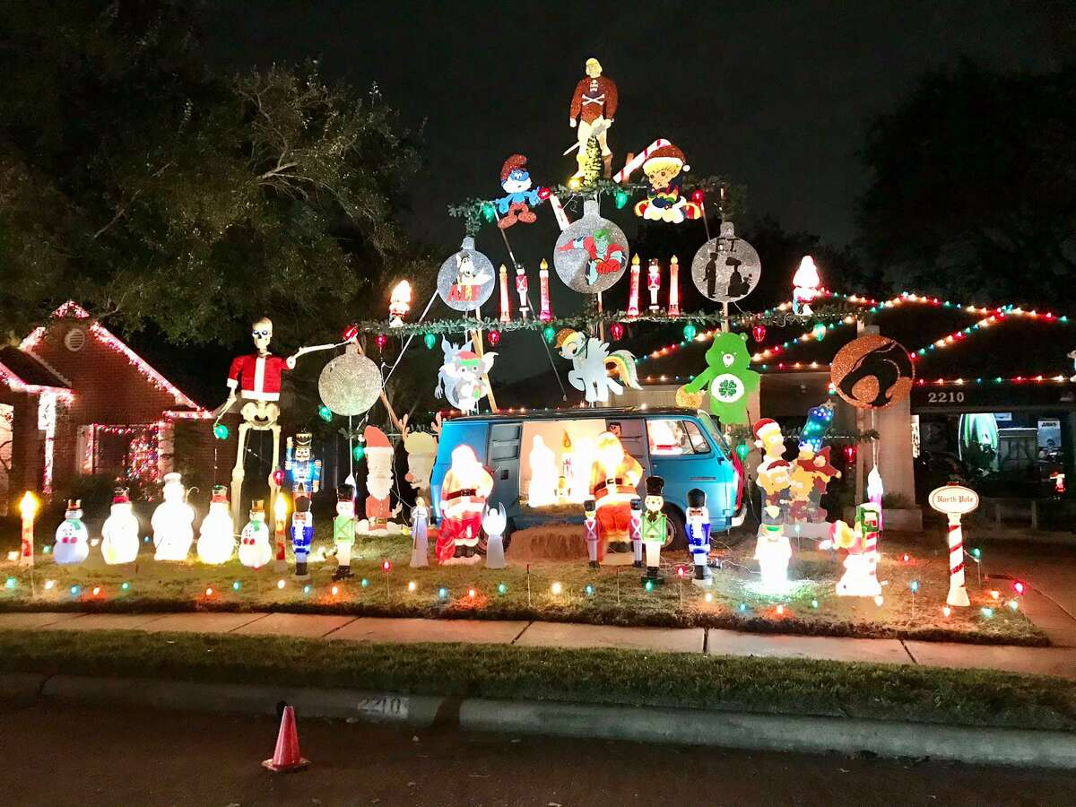 Pecan Grove homeowner Sean Foley added a blue Chevy van to his 40-foot Christmas light display. The Scooby Doo-like van serves as the manger for the festive Christmas scene.