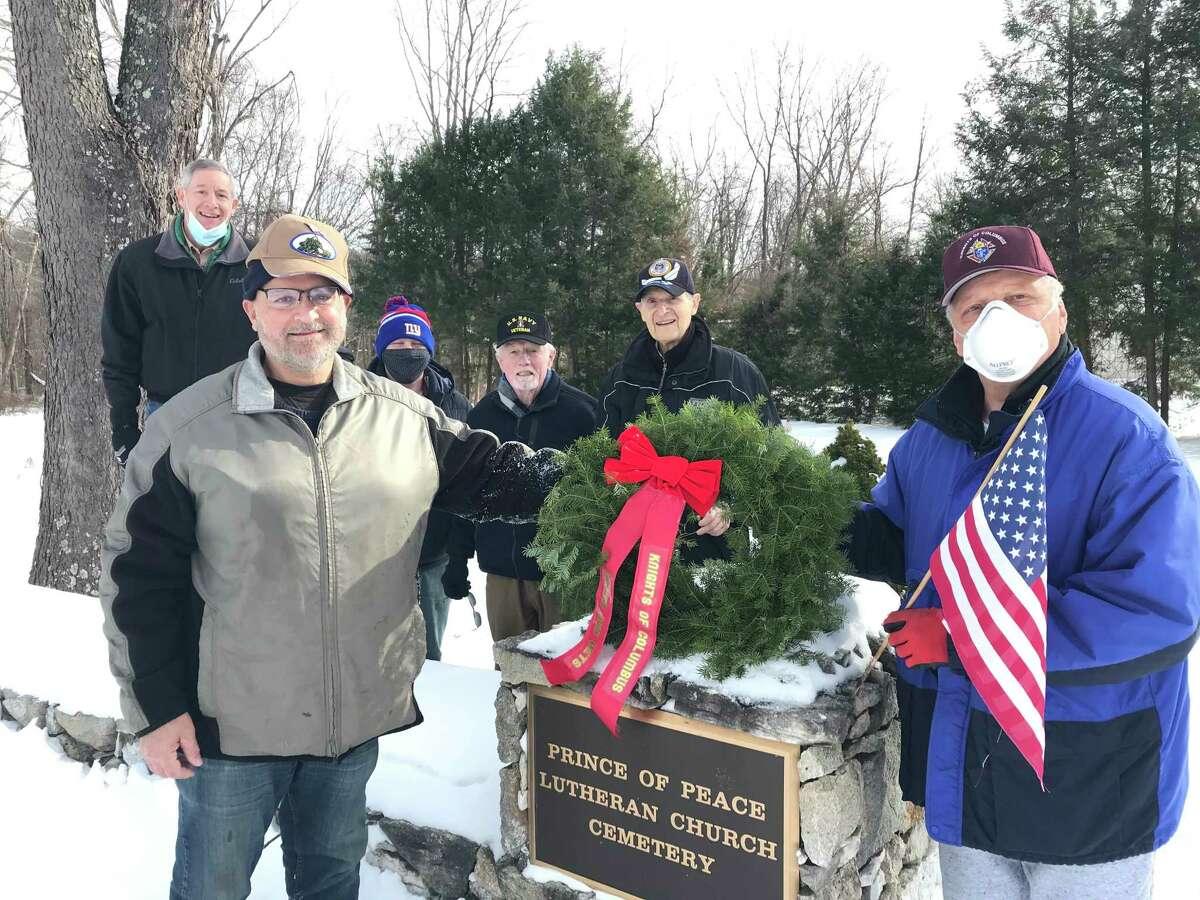 Brookfield Knights of Columbus members -- Rick Kappel (Brookfield), Tom Insinna (Danbury), State Representative Steve Harding (Brookfield), Jim McDermott (Danbury resident, Navy 1956 - 1959, served on the USS Thrush Mine Sweeper), Joe Wielock (Danbury resident, Air Force) and Mario Nacinovich (Brookfield) -- lay wreaths down for fallen veterans.