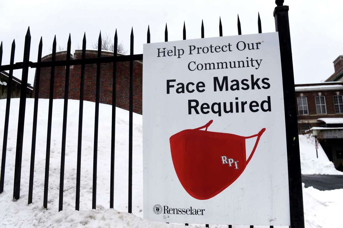 A sign posted on 15th Street reminds people that face masks are required on the Rensselaer Polytechnic Institute campus on Monday, Dec. 21, 2020, in Troy, N.Y. RPI students in the spring 2021 semester have been in quarantine and trapped in their rooms more than they have been out. (Will Waldron/Times Union)