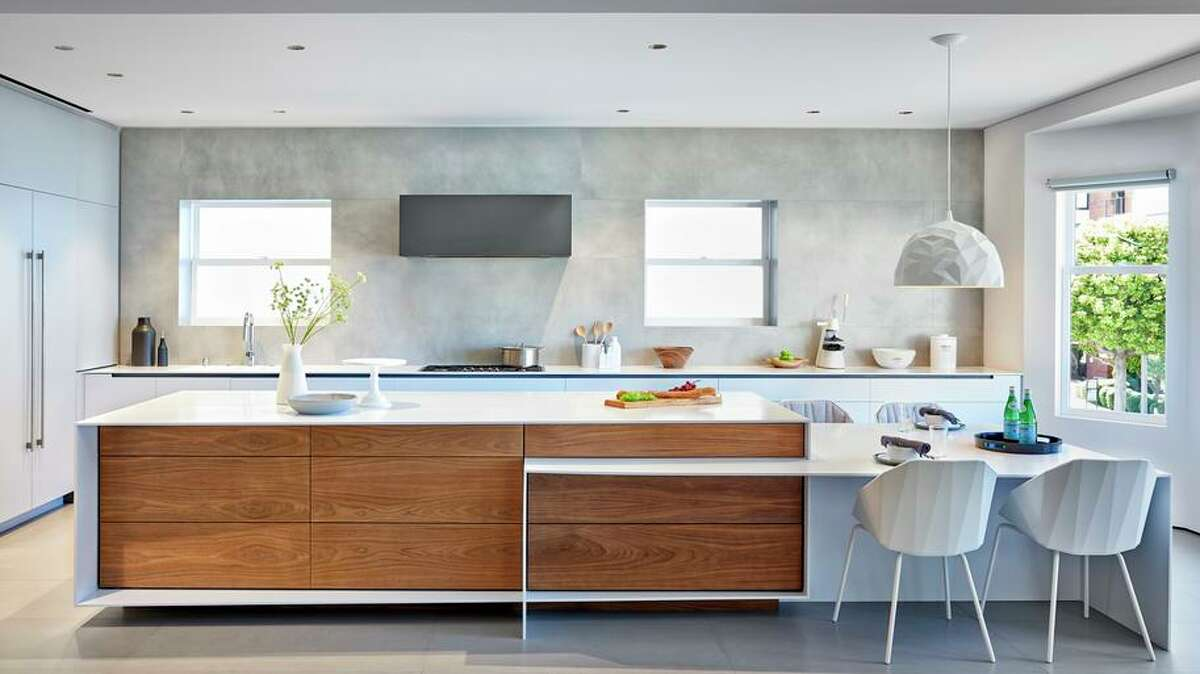 This kitchen conceptualized by Palo Alto architect Mary Maydan revolves around a large island.