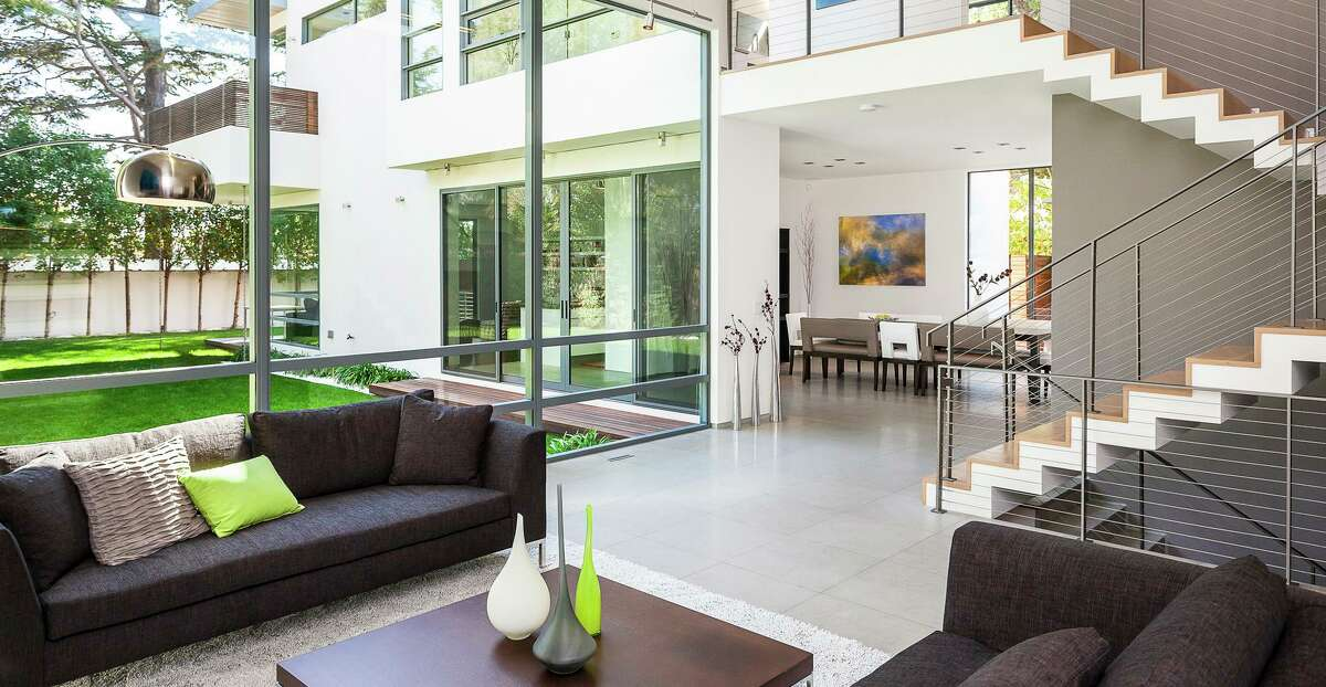 Large windows welcome sunlight into this home designed by Palo Alto architect Mary Maydan.