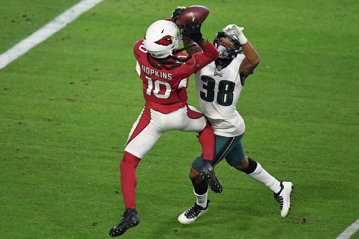 GLENDALE, ARIZONA - DECEMBER 20: DeAndre Hopkins #10 of the Arizona Cardinals makes the catch and scores during the fourth quarter against Michael Jacquet #38 and the Philadelphia Eagles at State Farm Stadium on December 20, 2020 in Glendale, Arizona. The Cardinals defeated the Eagles 33-26. (Photo by Norm Hall/Getty Images)