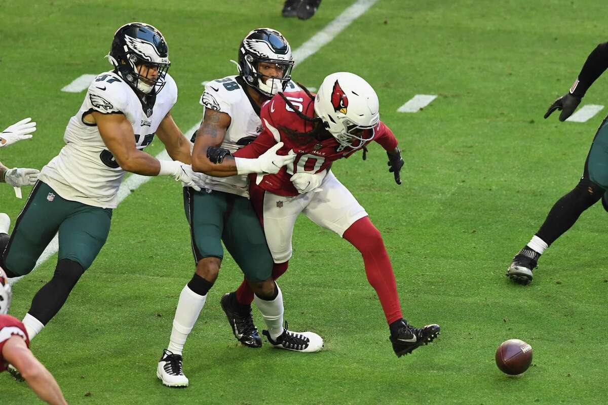 GLENDALE, ARIZONA - DECEMBER 20: DeAndre Hopkins #10 of the Arizona Cardinals attempts to get the ball back after a first quarter fumble against Michael Jacquet #38 of the Philadelphia Eagles at State Farm Stadium on December 20, 2020 in Glendale, Arizona. (Photo by Norm Hall/Getty Images)