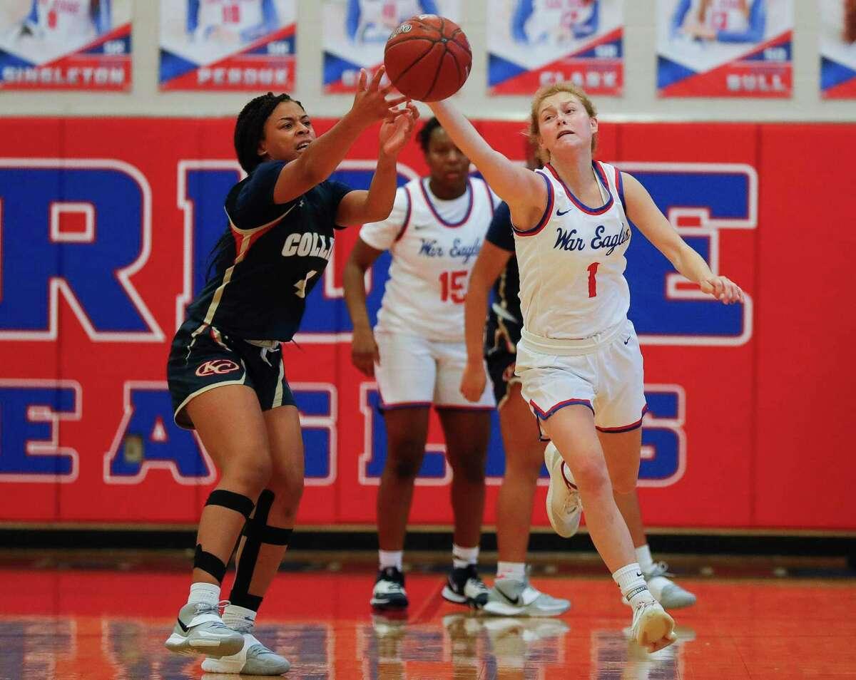 Oak Ridge guard Nikki Petrakovitz (1) tips the ball away from Klein Collins guard Quinnia Nolan (4) during the second quarter of a non-district high school girls basketball game at Oak Ridge High School, Saturday, Nov. 14, 2020.