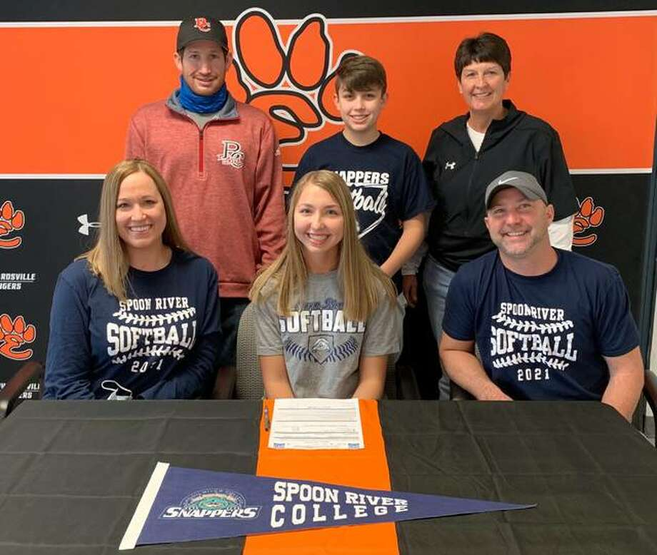 Edwardsville senior Jayna Connoyer, seated center, will play college softball for Spoon River. She is joined by her family and EHS coach Lori Blade. Photo: Matt Kamp|The Intelligencer