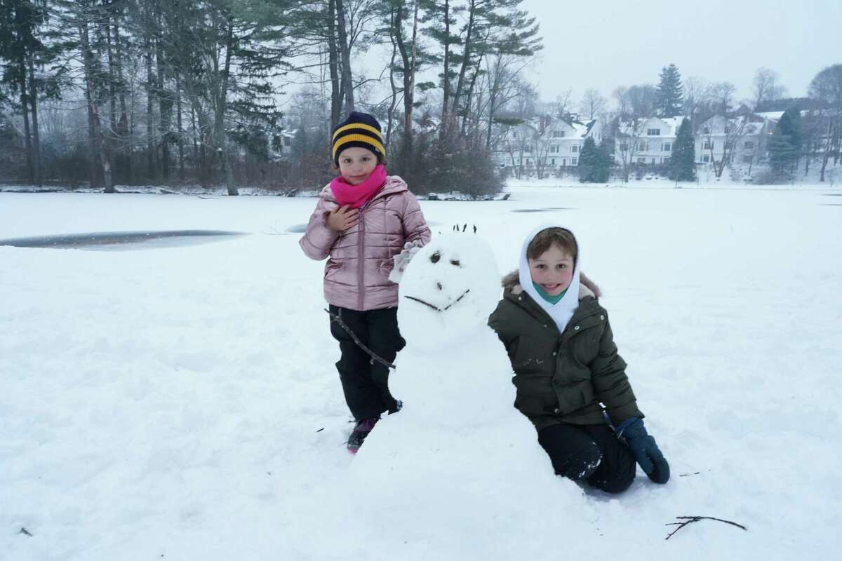 Aquinnah Maloney, 4, and Luke Maloney, 7, made a snowman in Mead Memorial Park.
