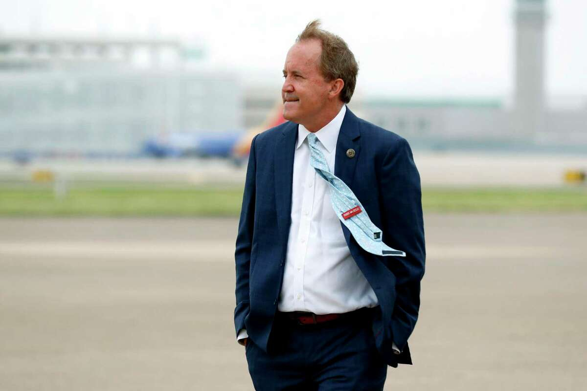 FILE - In this June 28, 2020 file photo, Texas' Attorney General Ken Paxton waits on the flight line for the arrival of Vice President Mike Pence at Love Field in Dallas. (AP Photo/Tony Gutierrez, File)