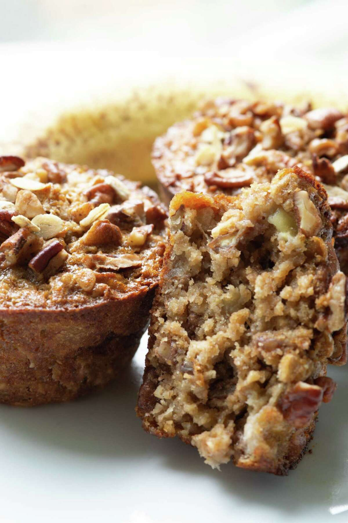 """Banana Nut Muffins recipe from """"Pinch-Dash-Done, A Gateway to Flavorful Recipes"""" by Vernita Harris and Beatrice Moore."""