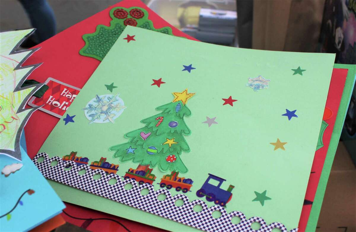 Middletown Public Schools elementary students created holiday cards for those who stopped by the Amazing Grace food pantry Monday to pick up boxes of food as part of the USDA Farmers to Families program.