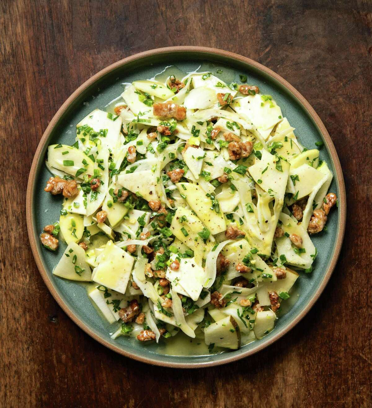 """Celery Root, Fennel, Pear, and Apple Salad with Meyer Lemon Vinaigrette from """"Chasing Flavor: Techniques and Recipes to Cook Fearlessly"""" by Dan Kluger with Nick Fauchald."""