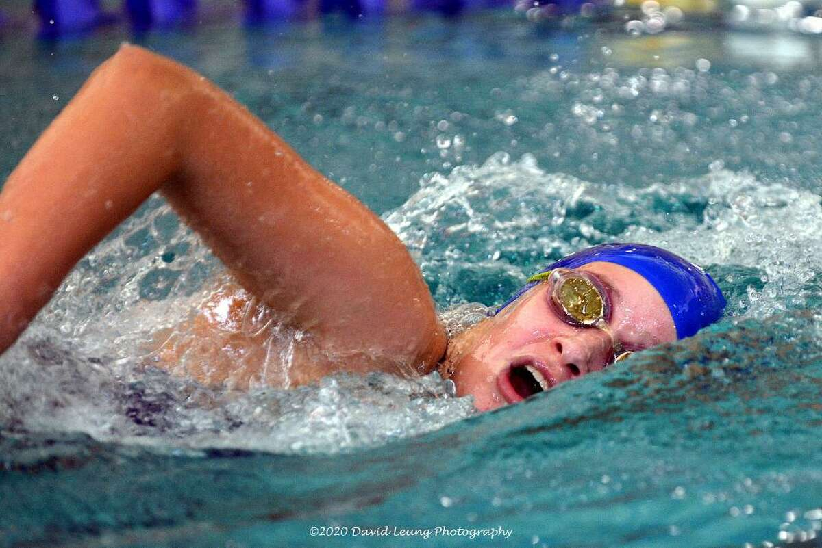 Leah Givens of Friendswood competes in the Friendswood Holiday Splash swimming and diving meet where she set a school record in in the 500-freestyle.