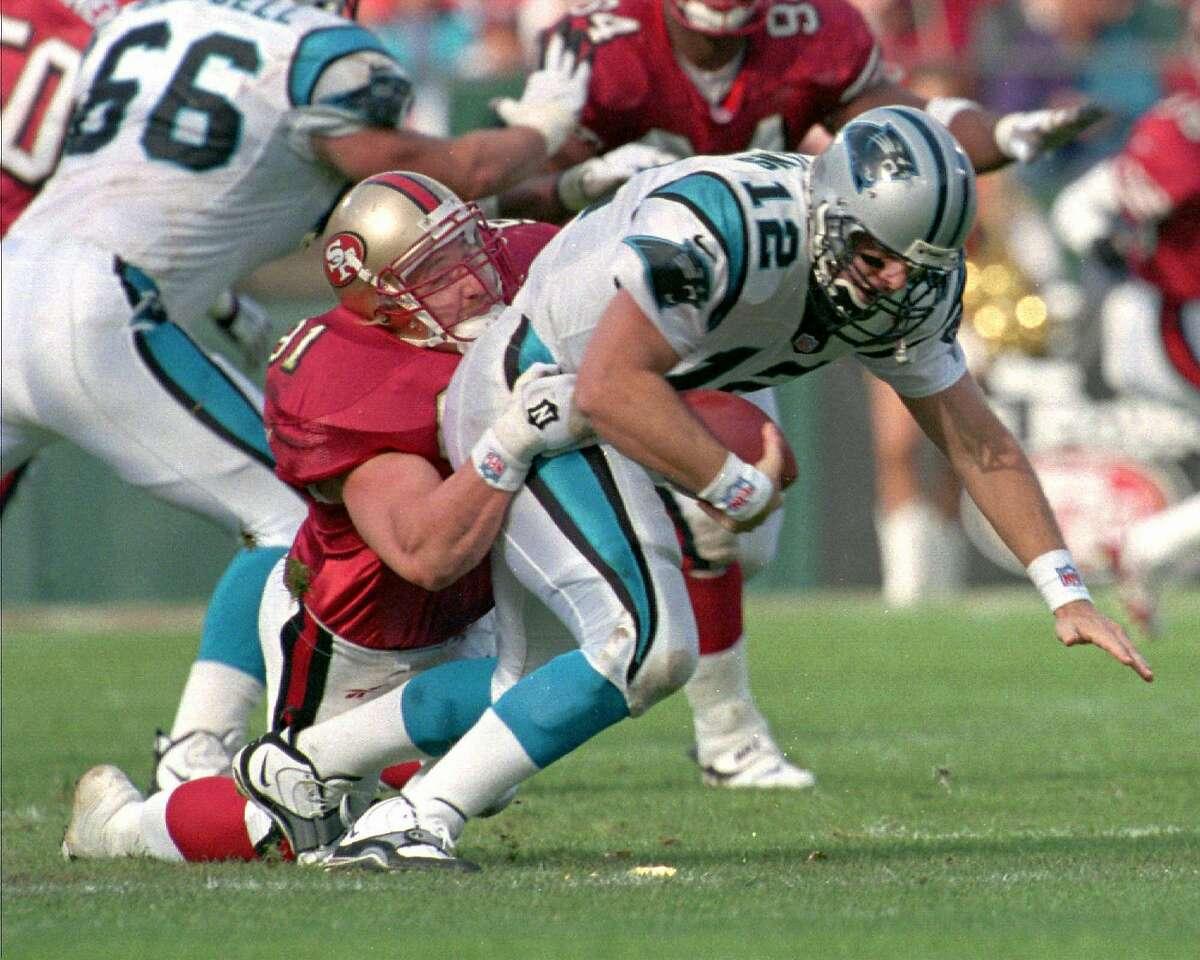 FILE--San Francisco 49ers linebacker Kevin Greene sacks Carolina Panthers quarterback Kerry Collins in the first quarter, Nov. 16, 1997, in San Francisco. (AP Photo/Susan Ragan)