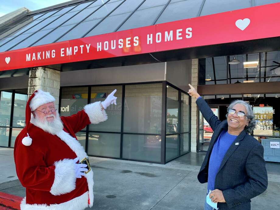 This year, the Houston Furniture Bank received 250 Bed-In-A-Bag sets from Ashley HomeStore to give to children in need along with a new bed. The sets will be distributed from the furniture bank's location in The Woodlands. Santa and Executive Director Oli Mohammed celebrate the donation on Dec. 21, 2020. Photo: Provided