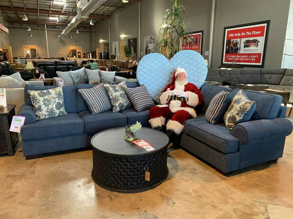 This year, the Houston Furniture Bank received 250 Bed-In-A-Bag sets from Ashley HomeStore to give to children in need along with a new bed. The sets will be distributed from the furniture bank's location in The Woodlands. Santa tests out the wares at Houston Furniture Bank in The Woodlands on Dec. 21, 2020.