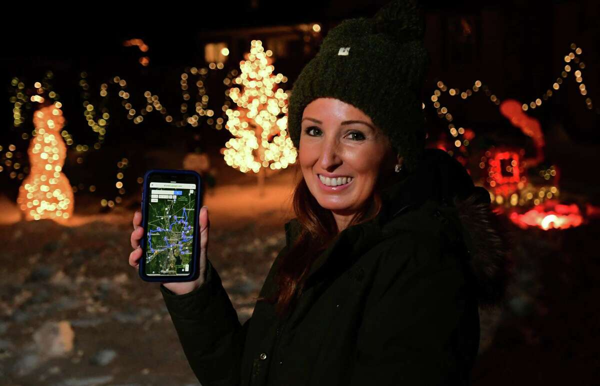 Norwalk resident and Board of Education member Erica DePalma at her father's home on Lorena Street Saturday in Norwalk. DePalma has created a map of some of the best Christmas lighting and decorations in Norwalk.