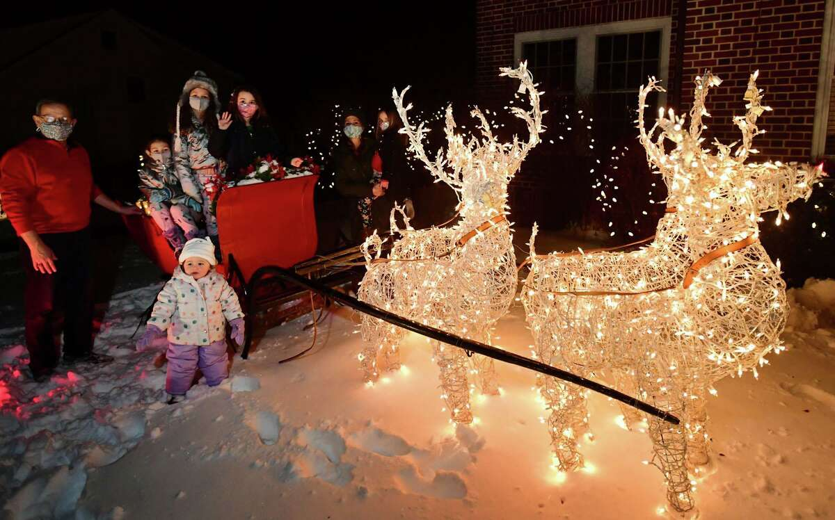 Norwalk resident and Board of Education member Erica DePalma at her father's home on Lorena Street with her daughter's and neices Saturday, December 19, 2020, in Norwalk, Conn. DePalma has created a map of some of the best Christmas lighting and decorations in Norwalk.