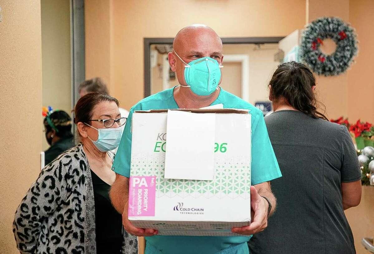 UMMC Dr. Joseph Varon holding the box of Moderna vaccine, which he described as