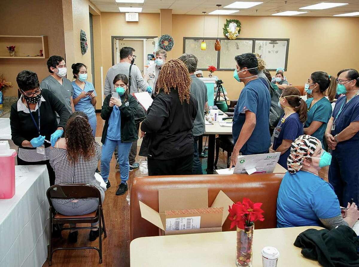 Medical staff at United Memorial Medical Center wait in line to receive the COVID-19 Moderna vaccine on Monday, Dec. 21, 2020, in Houston.