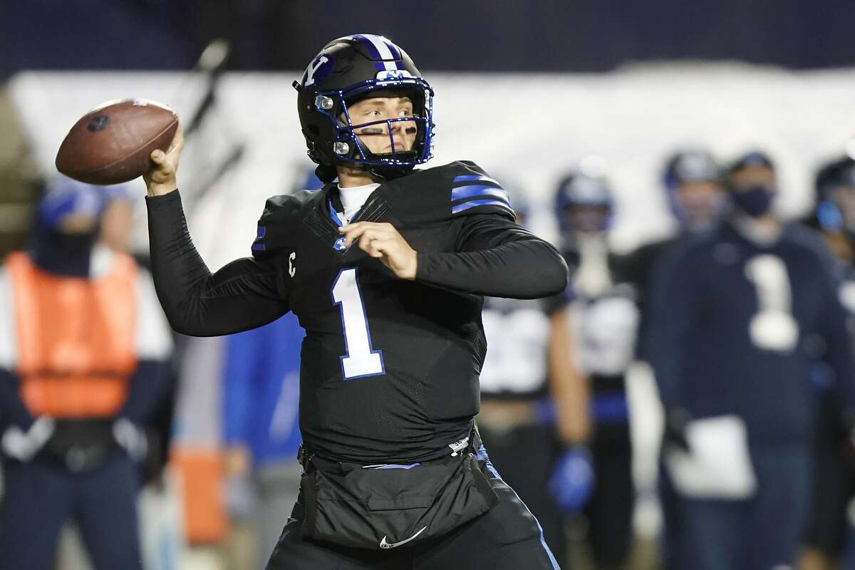 BYU quarterback Zach Wilson looks for a receiver during the first half of the team's NCAA college football game against San Diego State on Saturday, Dec. 12, 2020, in Provo, Utah. (AP Photo/George Frey, Pool)