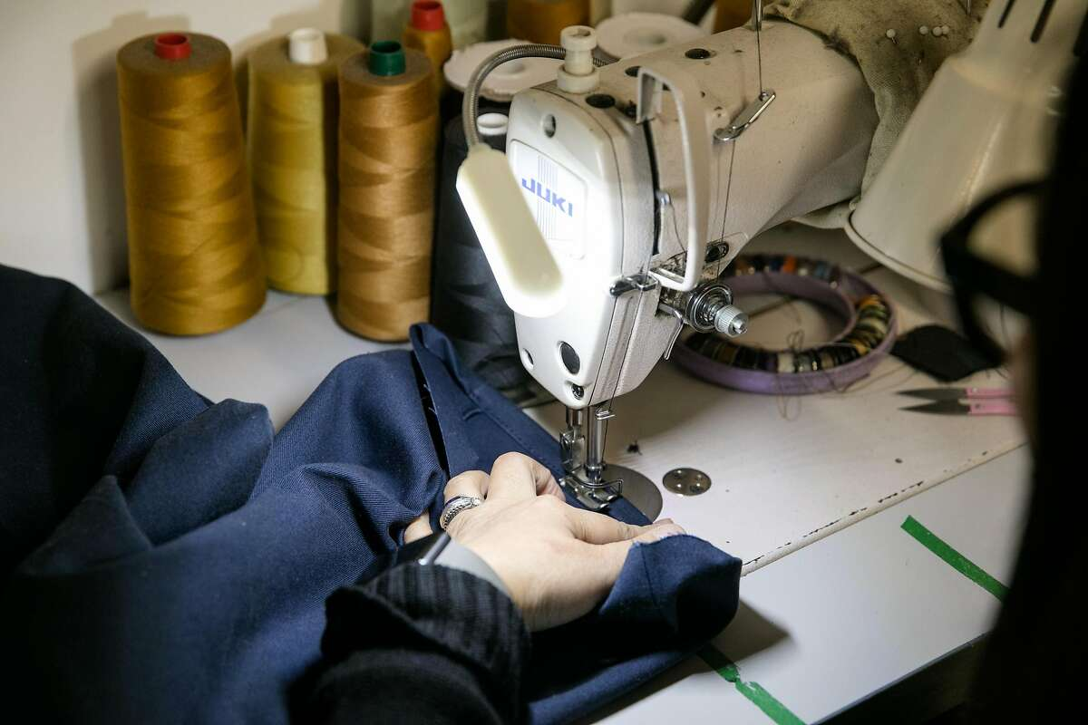 Tailor Puje Dorjsuren works on a design with a sewing machine at Advanced European Tailoring in Berkeley, Calif., on Dec. 18, 2020. The store served as inspiration for several scenes in Pixar's new animated film